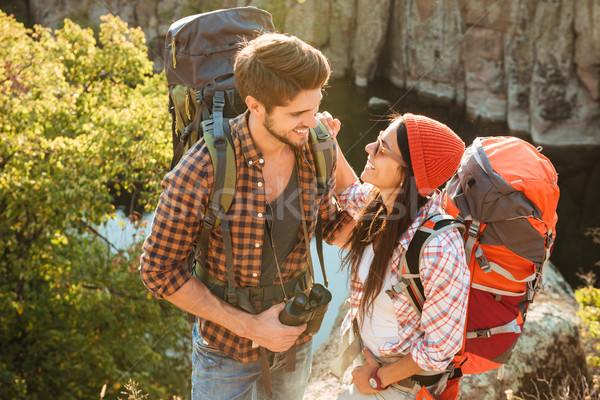 Adventure couple looking each other in eyes Stock photo © deandrobot
