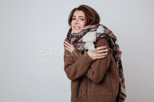 Young Freeze woman in sweater and scarf Stock photo © deandrobot