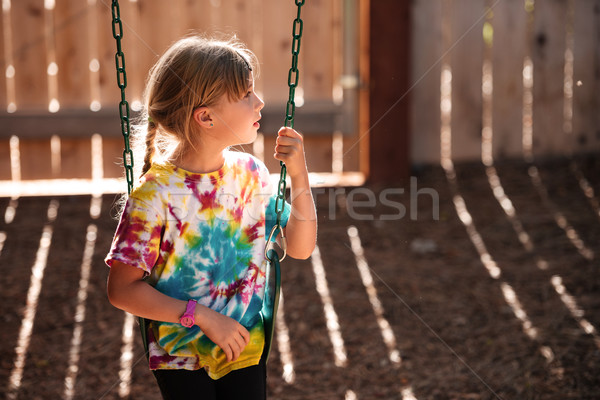 Young girl on playground Stock photo © deandrobot