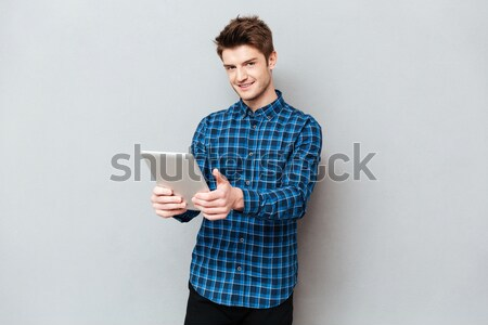 From below image of man in glasses with book Stock photo © deandrobot