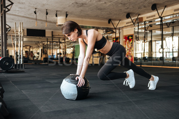 Sportswoman working out with ball in gym Stock photo © deandrobot