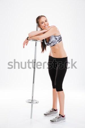 Sonriendo jóvenes mujer de la aptitud botella agua atractivo Foto stock © deandrobot