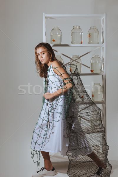 Teljes alakos csinos nő sétál tart halászháló csinos Stock fotó © deandrobot