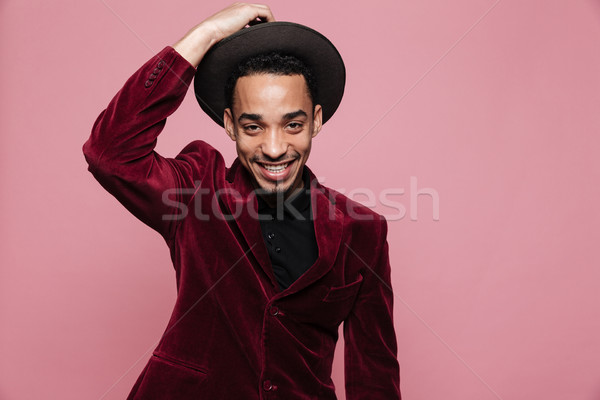 Portrait of a happy afro american man in stylish cloth posing Stock photo © deandrobot