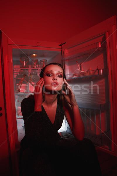 Függőleges kép nő ül hűtőszekrény ruha Stock fotó © deandrobot