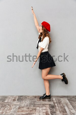 Vertical image of Hipster in shirt doing a high kick Stock photo © deandrobot