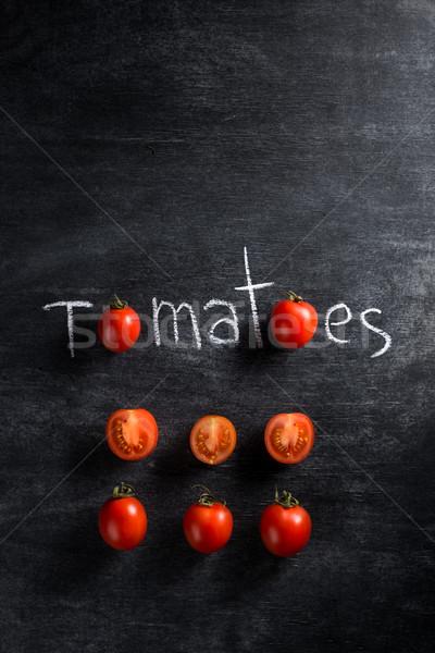 Cortar tomates escuro topo ver imagem Foto stock © deandrobot