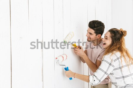 Man and woman painting wall Stock photo © deandrobot
