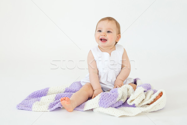 Little baby girl sitting on floor with plaid Stock photo © deandrobot