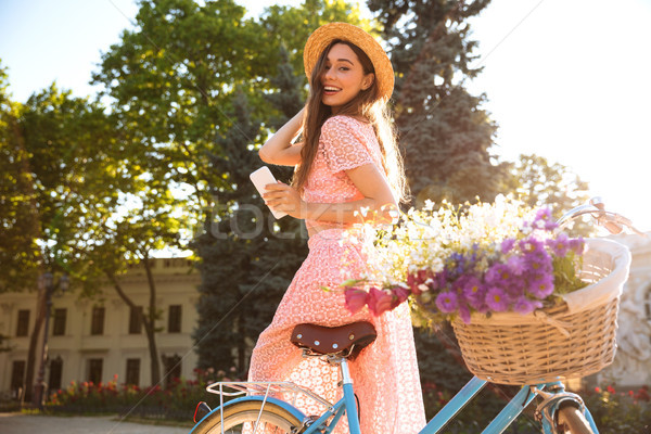 Lady улице велосипед телефон глядя Сток-фото © deandrobot
