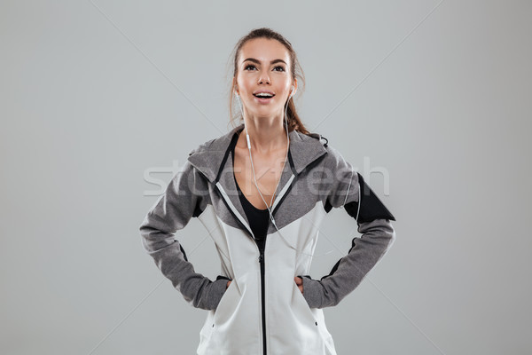 Laughing female runner holding hands on hip Stock photo © deandrobot