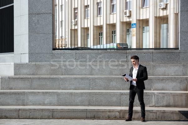 Empresário dobrador em pé escada negócio Foto stock © deandrobot