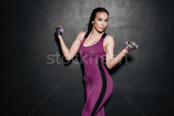 Portrait of a young sexy fitness woman doing sport exercises Stock photo © deandrobot