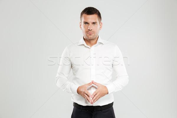 Concentrado joven foto blanco camisa aislado Foto stock © deandrobot