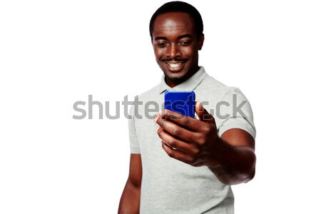 Szczęśliwy Afryki człowiek ekranu Zdjęcia stock © deandrobot