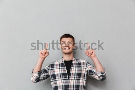 Photo heureux séduisant jeune homme à carreaux Photo stock © deandrobot