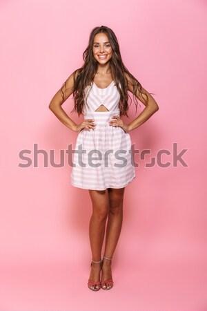 Portret cute jonge vrouw rode jurk aanraken Stockfoto © deandrobot