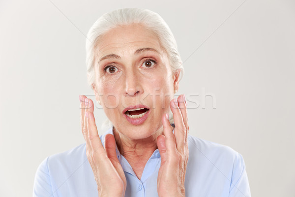 Portrait of amazed beautiful old woman, looking at camera Stock photo © deandrobot