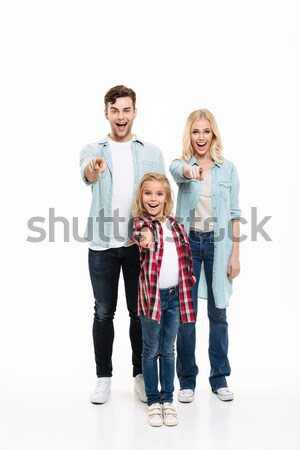 Full length portrait of a smiling family with a child Stock photo © deandrobot