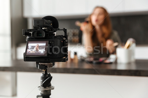 Attractive healthy young girl recording her video blog Stock photo © deandrobot