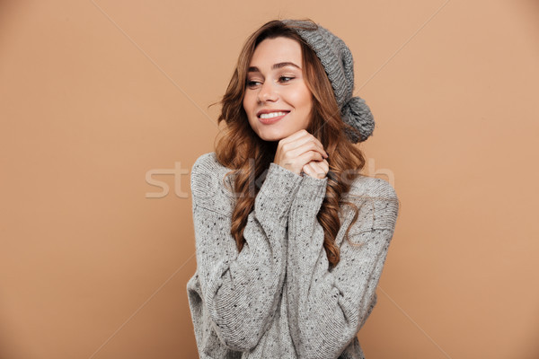 Charming young brunette woman in warm clothes holding hands, loo Stock photo © deandrobot