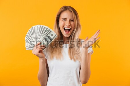 Portrait of a happy excited woman talking on mobile phone Stock photo © deandrobot