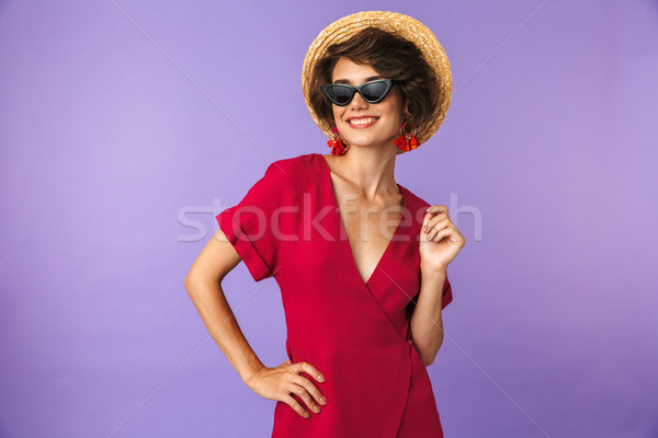 Smiling Pretty brunette woman in dress, straw hat and sunglasses Stock photo © deandrobot