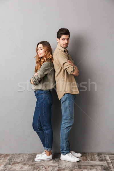 Full length portrait of an upset young couple Stock photo © deandrobot