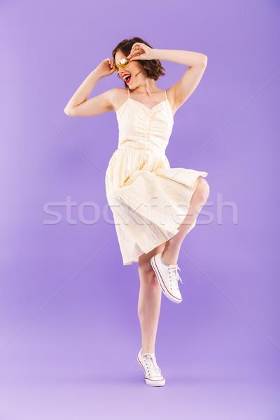 Animado mulher dança isolado roxo parede Foto stock © deandrobot