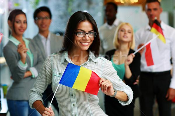 Gelukkig zakenvrouw vlag Roemenië collega's Stockfoto © deandrobot