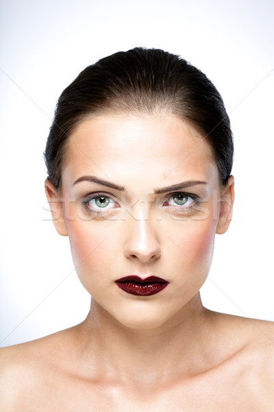 Stock photo: Beauty portrait of a young serious woman with fresh skin