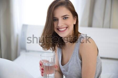 Retrato alegre mujer vidrio agua fondo Foto stock © deandrobot