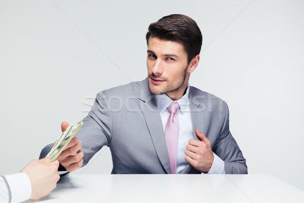 бизнесмен сидят таблице серый глядя Сток-фото © deandrobot