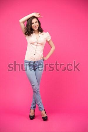 Boldog nő áll rózsaszín teljes alakos portré Stock fotó © deandrobot