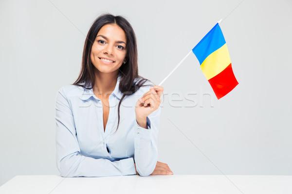 Nő ül asztal román zászló mosolyog Stock fotó © deandrobot
