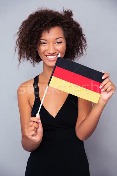 Africano americano mulher Alemanha bandeira Foto stock © deandrobot