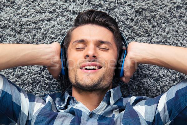 Man listening the music  Stock photo © deandrobot