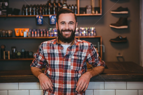 Happy cheerful man with beard in barbershop after visiting barber Stock photo © deandrobot