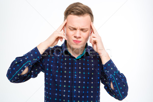 Stressful depressed blond man touching his temples and having headache Stock photo © deandrobot
