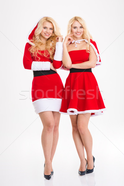 Two young blonde sisters twins in santa claus costumes  Stock photo © deandrobot