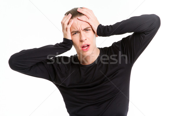 Portrait of a stressed man touching his head  Stock photo © deandrobot