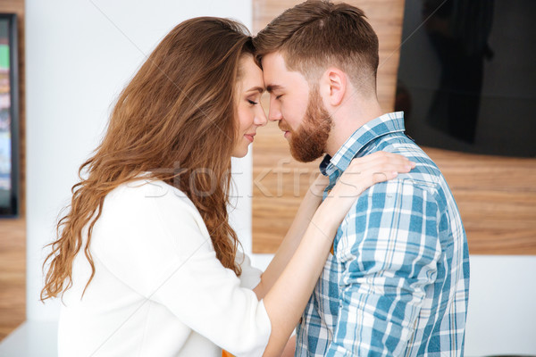 Couple hugging at home Stock photo © deandrobot