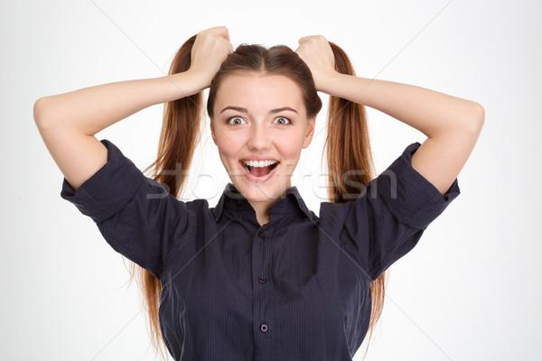 Vicces izgatott fiatal nő kettő kezek fehér Stock fotó © deandrobot