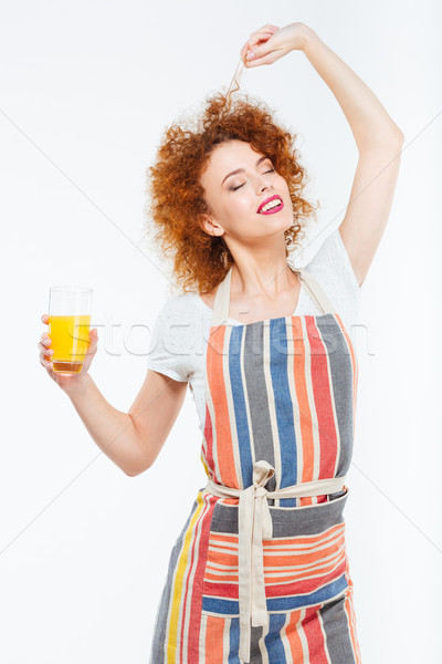 Attractive relaxed woman posing with glass of juice Stock photo © deandrobot