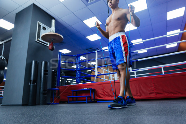 Boxer with skipping rope Stock photo © deandrobot