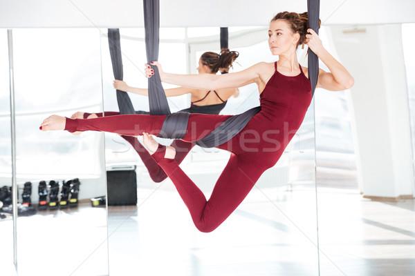 Concentrato bella diverso yoga Foto d'archivio © deandrobot