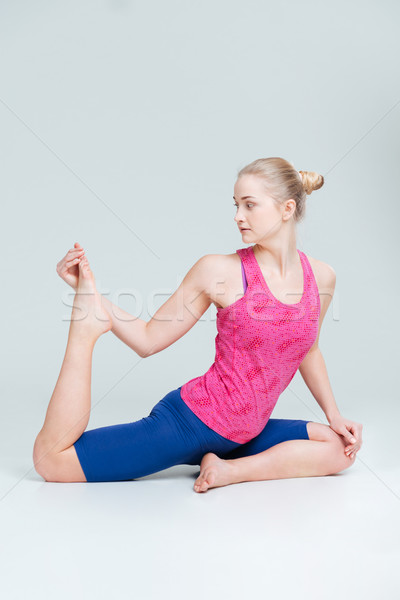 Stock photo: Young woman stretching legs