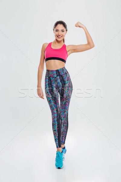 Deportes mujer bíceps retrato Foto stock © deandrobot