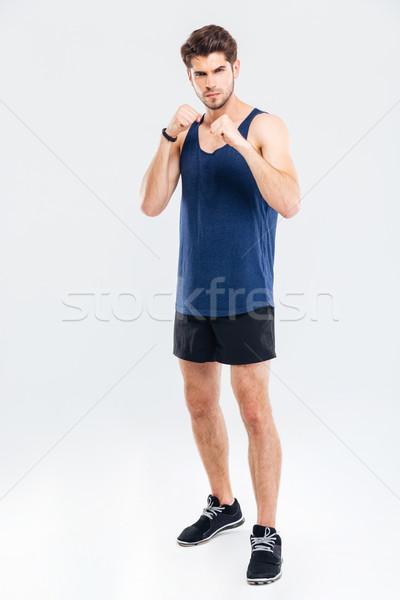 Muskularny mężczyzna myśliwiec stałego odizolowany młodych Zdjęcia stock © deandrobot
