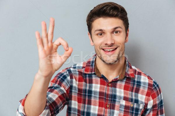 Portré boldog férfi mutat oké kézmozdulat Stock fotó © deandrobot